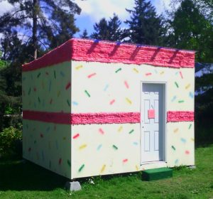 shed decorated to look like birthday cake with sprinkles