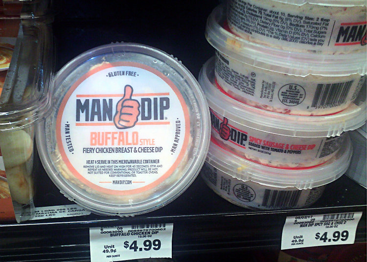 "tub of buffalo cheese dip labeled ""MAN DIP"""