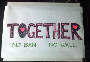 "handmade sign ""TOGETHER / NO BAN NO WALL"""
