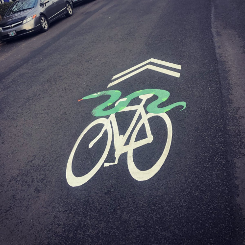 Sharrow with painted snake